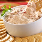 Zesty Pepper and Onion Dip - Try this super-simple tangy pepper and onion dip the next time you need an easy appetizer. All it takes is prepared pepper and onion relish, cream cheese, and some crackers to serve with it.