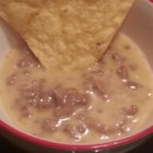 Taco Queso Dip - Make a taco-seasoned cheese and beef dip with this recipe designed for ideal tortilla chip dippin'! There's even beer in it!