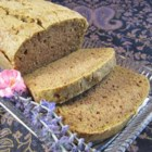 Healthier Zucchini Bread IV - Yielding two loaves, this sweet and cinnamony zucchini bread just got healthier with less sugar, more nuts, and the addition of buckwheat flour.