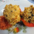 Meatless Stuffed Peppers - This stuffed pepper recipe is well worth the effort.  Peppers are stuffed with rice, tofu, parsley, mushrooms, bread crumbs, and walnuts and baked in a bed of crushed tomatoes.