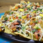 Caribbean Nachos - This recipe combines spicy, sweet, and salty with a definite Caribbean flair. The multigrain chips make it a heartier and healthier dish, and add a wonderful nutty flavor. Chicken can be subbed for the shrimp, but increase the cooking time as necessary. Serve with sour cream and picante salsa.