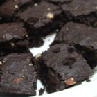 Triple Chocolate Tofu Brownies - Dense and rich brownies are made with whole wheat flour and tofu.