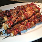 Slayer's Sweet, Tangy, and Spicy Kabobs - A maraschino cherry and pineapple chunk finish off these tasty and spicy chicken skewers.
