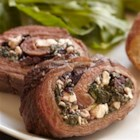 Greek Stuffed Bison Steak - Filled with a mixture of spinach, feta cheese, and kalamata olives, marinated bison flank steak is roasted or grilled in this Greek-inspired preparation.