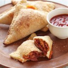 Cheesy Bison Pepperoni Pizza Turnovers - These pizza turnovers with spicy bison sausage with pepperoni seasoning are easy to make for a great snack or weeknight dinner.