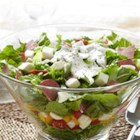 Italian Layered Salad with Bison Pepperoni - Layers of crisp, colorful greens and veggies topped with chopped bison sausage with pepperoni seasoning and a creamy basil dressing make a perfect lunch or dinner side salad.