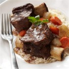 Asian Bison Short Ribs - Sesame oil, soy sauce, orange juice, and cayenne pepper enhance the flavor of these rich bison ribs cooked long and slow with vegetables.