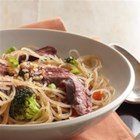 Asian Noodle Bowl - Tender slices of broiled bison skirt steak are served atop steaming bowls of Asian-inspired noodle soup with veggies and your choice of toppings.