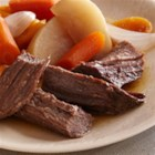 Beer-Braised Bison Brisket with Root Vegetables - Slowly braised with root vegetables in a beer and horseradish sauce, bison makes a wonderfully hearty meal.