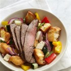 Panzanella Salad with Bison Flank Steak - Flavorful grilled bison flank steak is sliced thinly across the grain for maximum tenderness and served with an Italian-inspired toasted bread salad with tomatoes, fresh mozzarella cheese, and basil leaves.