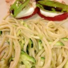 Fresh Zucchini Pasta Sauce - Freshly grated zucchini marinates with garlic and olive oil creating a simple and delicious sauce for angel hair pasta. The hot pasta cooks the zucchini in the bowl!