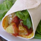 Curried Chipotle Potato, Spinach and Cheese Wraps - This curried potato wrap is made with Muenster cheese, spinach, and chipotle salsa.