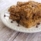 Granola Bars - Toasted coconut and oats mix in a sauce made with honey and peanut butter for these granola bars.