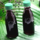 Elderberry Syrup - Rumor has it that a tablespoon of elderberry syrup will help prevent or fight off a cold or the flu. However, it's delicious served on waffles, ice cream, or anywhere you'd like to serve an interesting and tasty fruit syrup.