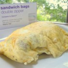 Easy Omelet in a Bag - Put all the fixings for an omelet in a plastic bag and boil for a fun and easy 'omelet in a baggie' perfect for camping.