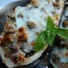 Eggplant With Mushroom Stuffing - Eggplant halves hollowed out and stuffed with mushroom filling are baked underneath a layer of Swiss cheese.