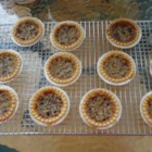 Raisin Butter Tarts - These diminutive sweet tarts are made from brown sugar, lemon juice, melted butter, egg, lots of raisins and a smidgen of nutmeg. They bake up golden and delicious. Serve with a dollop of whipped cream.