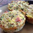 Mini Frittatas with Quinoa - Savory bites of quinoa, eggs, zucchini, cheese, and ham are equally excellent hot or cold. Ideal for breakfast, brunch, lunch, or dinner.