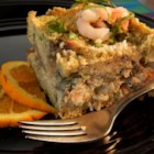 Seafood Strata with Pesto - Crab and shrimp are layered in a breakfast casserole with Swiss cheese and bread. This is a wonderful recipe that can be prepared ahead of time. Serve with a crisp green salad and lots of hot French bread.