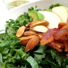 Kale, Apple, Avocado, and Bacon Salad - This great way to use kale has everything you could want in a salad: the creaminess of avocado, the tanginess of apple, the crunch of almonds, and, of course, the delicious magic of bacon.