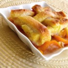Too Easy Peach Cobbler -  When fresh peaches hit the farm stand, this is the dessert to try. Fresh peaches are sliced and arranged in an 8x8-inch pan and covered with a layer of white bread. A sweet butter and egg mixture is poured over the top, and then this yummy concoction bakes until it becomes a golden, delicious cobbler.