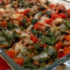 Spinach and Bean Casserole - Try this recipe for a change of pace.  Black-eyed peas are cooked in a pressure cooker then combined with onion, spinach, tomatoes and fennel.