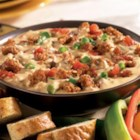 Hot Sausage Dip from Hatfield(R) - Hot Italian sausage is browned and stirred into a creamy mixture of cheese, spicy tomatoes, and chopped green onions--a perfect dip for corn tortilla chips.