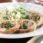 Sausage and Broccoli Rabe Tenderloin Roulades from Hatfield(R) - Lots of fresh herbs and hot Italian sausage bring a gourmet touch to this impressive stuffed, rolled pork tenderloin served with creamy risotto.