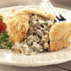 Sausage Gravy Stuffed Biscuits from Hatfield(R) - Biscuit dough cups are filled with sage sausage gravy, topped with a biscuit circle, sealed up and baked for a delicious breakfast or brunch treat.