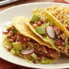 Turkey Tacos with Spicy Tomatoes - Browned ground turkey is simmered with diced tomatoes, lentils and spices for a quick and easy taco filling.