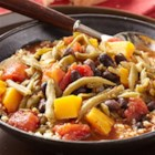 Butternut Squash and Black Bean Stew with Tomatoes and Green Beans - Cubes of butternut squash are simmered in a zesty tomato sauce with spices, green beans and black beans and served over couscous.