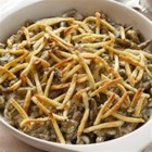 Creamy Green Beans with Crunchy Pita Strips - Green beans are cooked in a sour cream sauce flavored with oregano and topped with crunchy strips of pita bread for a side dish that's perfect for your family dinner.
