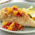 Cumin-Crusted Chicken Breasts with Chipotle Peach Salsa - Oven-baked chicken breasts with a crunchy bread crumb coating are served with a savory-sweet side of homemade peach salsa in this satisfying dish.