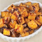 Sea Salt Sweet Potatoes - These sweet potatoes are baked with a drizzle of maple syrup until they are tender and lightly browned then topped with pecans and a sprinkle of coarse sea salt for a finishing touch that will turn this simple dish into something special.