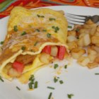 Delicious Ham Omelette - An omelet loaded with potatoes, ham, and Cheddar cheese is a delicious way to start the weekend.