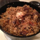 Uzbek Plov (Lamb and Rice Pilaf) - Spiced lamb is simmered with rice and whole heads of garlic in this Middle East-inspired dish.