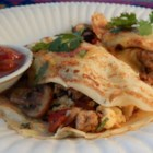 Savory Southwestern Crepes - Crisp and golden crepes filled with sausage, vegetables, eggs and topped with Hollandaise sauce.