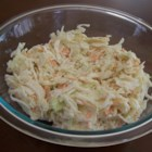 Traditional Creamy Coleslaw - A traditional and simple coleslaw has a creamy mayonnaise dressing made with lemon juice, sugar, and horseradish for a sweet and zingy flavor. It goes together quickly because the recipe calls for a bag of ready-made coleslaw mix.