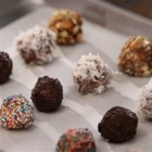 Utokia's Chocolate Peanut Butter Candies - Chocolate and peanut butter candies are rolled in chopped nuts, flaked coconut, or sprinkles--your choice--for these sweet little treats individually wrapped in parchment paper.