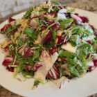 Tri-Color Chopped Salad with Pine Nuts and Parmesan Cheese - This chopped salad mixes arugula, Belgian endive and radicchio with the magical combo of pine nuts and Parmesan, tossed in a mustard and oregano vinaigrette.