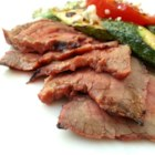 Beerbecue Beef Flank Steak - All you need for a flavorful barbeque sauce for inexpensive, tasty beef flank steak is a cup of beer and some pantry items like ketchup, molasses, and spices.