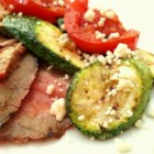 Zucchini and Blue Cheese Side - Blue cheese tops off this speedy side dish of zucchini and fire roasted tomatoes.