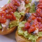Avocado Salsa and Sardine Frenchy - Toasted French bread slices get topped with mashed avocado salsa, sardines, and seasoned tomatoes in this intriguing combination of flavors.