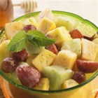 Fruit Salad with Mint Honey-Lime Dressing - Freshen up your summer salad with a honey-lime dressing. Surprisingly sweet, the honey heightens the freshness of summer's best picks.