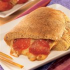 Honey Wheat Calzone - Honey's humectant nature comes into play with this deliciously sweet Honey Wheat Calzone. The yummy crust locks in the cheesy goodness waiting inside . . . it's almost too good to be true.