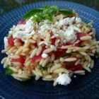 Orzo and Tomato Salad with Feta Cheese - A cold pasta salad with orzo, green olives, feta cheese, parsley, dill, tomato, olive oil, and lemon juice. If you don't have fresh herbs, use 1 teaspoon dried.