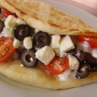 Beef Gyro - Beef gyros loaded with homemade tzatziki sauce, feta cheese, tomatoes, and onion is a hearty Greek-inspired sandwich served in a pita bread.
