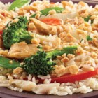 Thai Curry Delight - A delicious lunch time or quick dinner recipe . . . heat Minute(R) Ready to Serve Jasmine rice, add in coconut milk and zesty curry powder, just the right touch of stir-fry veggies, and cooked shredded chicken--top with crushed peanuts.