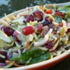 Coleslaw With Grapes and Spinach - Red grapes are the surprise ingredient in a sweet, tangy, and colorful coleslaw made with broccoli, spinach, and red onion.