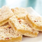 Lemon Curd Bars - Using a prepared lemon curd makes baking tangy, fruity lemon bars so easy you can whip up a batch anytime. Coconut and almonds add extra richness and texture.